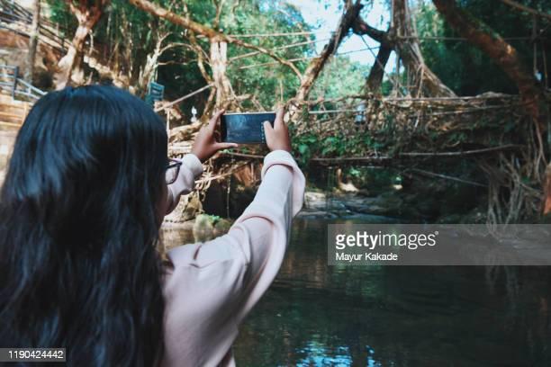 Girl taking photo using mobile camera