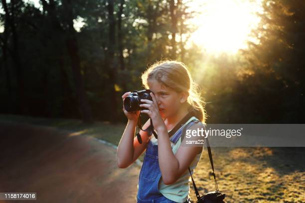 girl taking photos in a natural park - photographer stock pictures, royalty-free photos & images