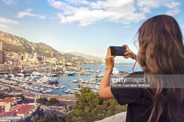 girl taking photos of the monaco bay - monte carlo stock pictures, royalty-free photos & images