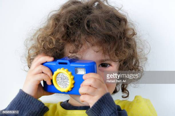 Girl taking photos with camera