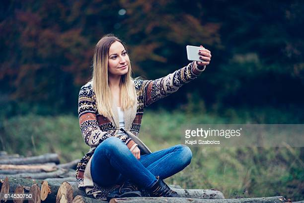 Girl taking selfie in the nature