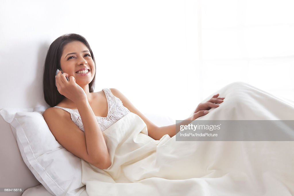 Girl talking on mobile phone : Stock Photo