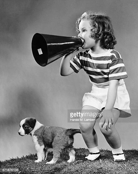 girl talking through megaphone - pawed mammal stock pictures, royalty-free photos & images