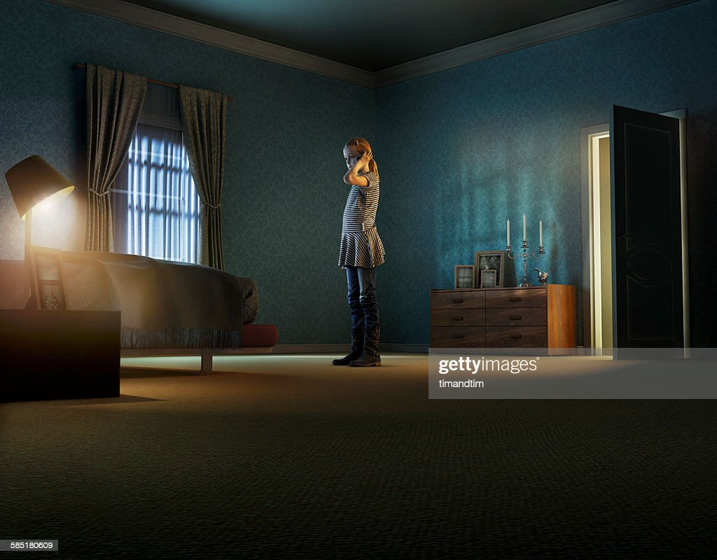 Girl talking through smartphone in a room : Stock Photo