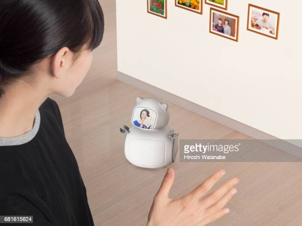 Girl talking with mother in the screen with Personal Robot