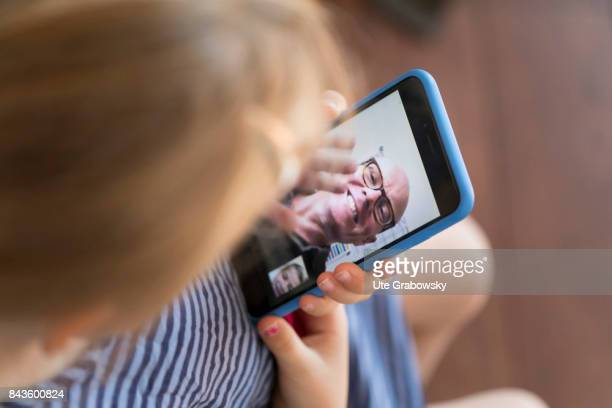 A girl talks to her grandfather via Facetime on August 07 2017 in Bonn Germany
