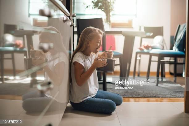 girl tasting whipped chocolate cream - abbuffata foto e immagini stock