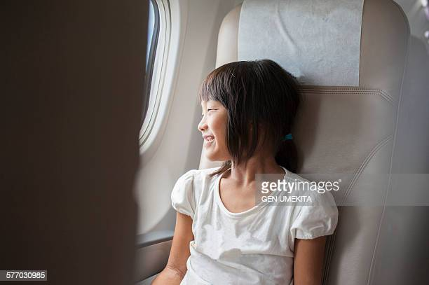 Girl taveling in airplane
