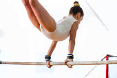 girl teenager doing sports gym crossbar