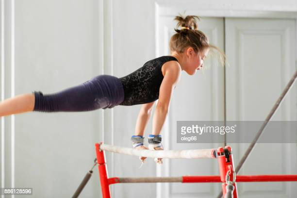 girl teenager doing sports - parallel bars gymnastics equipment stock photos and pictures