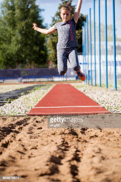girl teenager trains in long jump - women's field event stock pictures, royalty-free photos & images