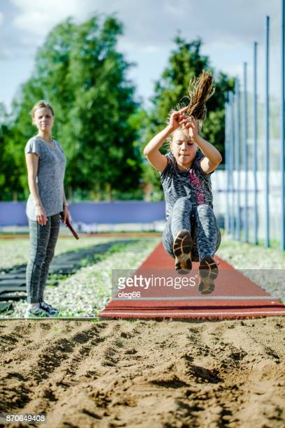 girl teenager trains in long jump - long jump stock pictures, royalty-free photos & images
