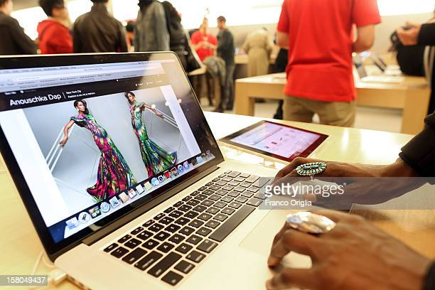 A girl tests a laptop at the NY Apple store on December 5 2012 in New York City Christmas holiday season in New York is the most wonderful time of...