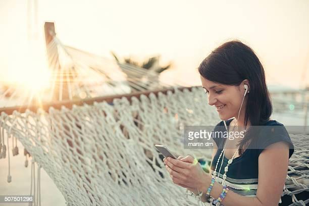 Girl texting in hammock