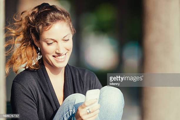 girl texting messages on smart phone - mlenny stock pictures, royalty-free photos & images