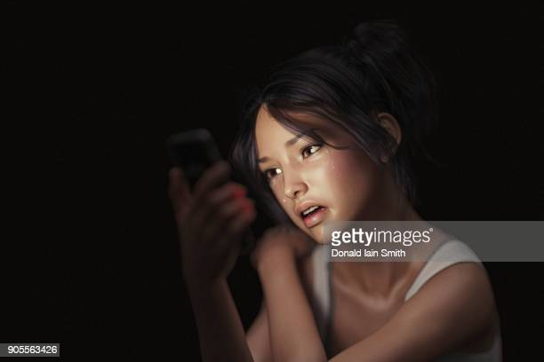 girl texting on cell phone and crying - cyberbullying fotografías e imágenes de stock