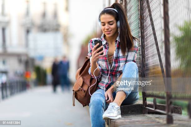 girl texting on smartphone in the city - listening stock pictures, royalty-free photos & images