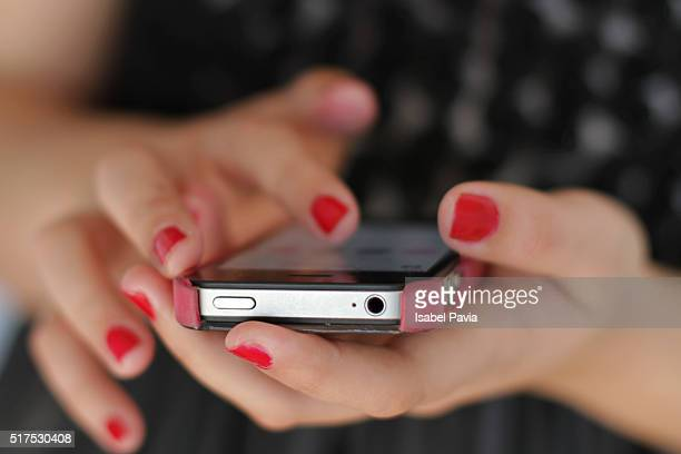 Girl texting on smartphone