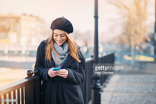 Girl texting outdoors in the winter
