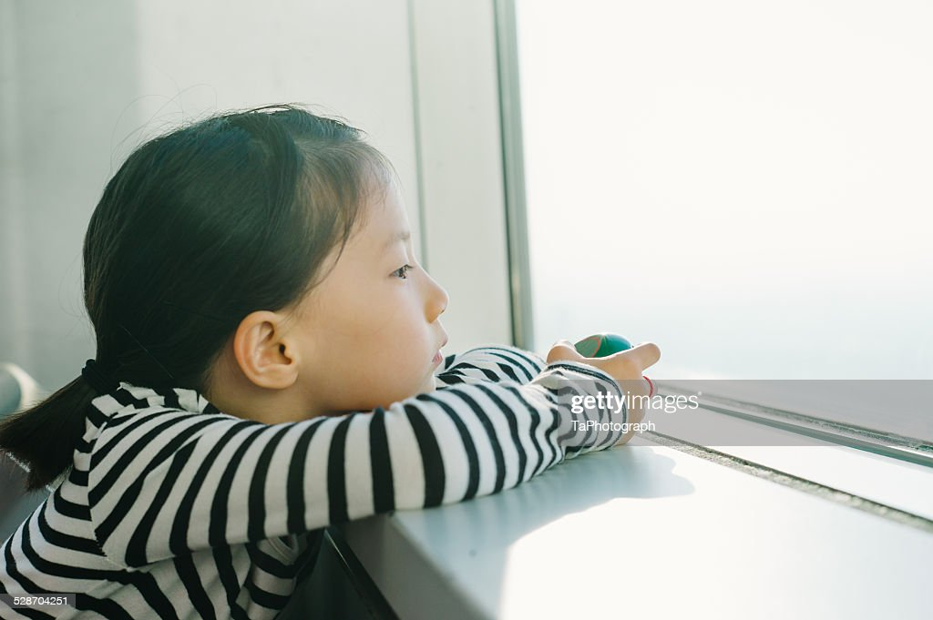 Girl thinking about the future : Stock Photo