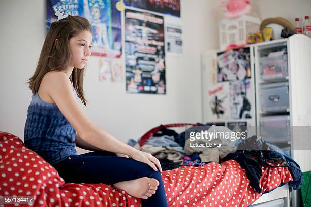 Girl thinking on bed