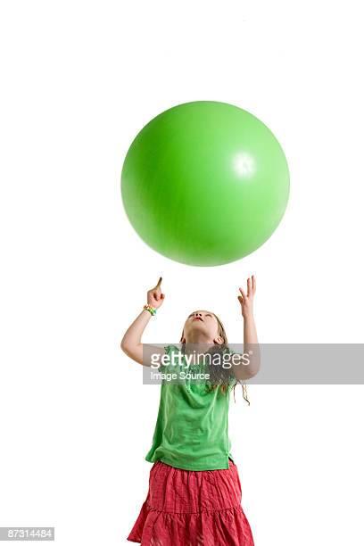 A girl throwing a ball