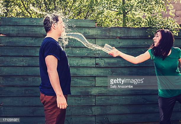 Girl throwing a drink in a mans face