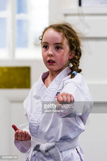 A girl throwing a punch during karate training.