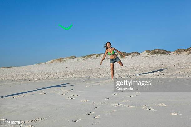 girl throwing boomerang - boomerang stock pictures, royalty-free photos & images