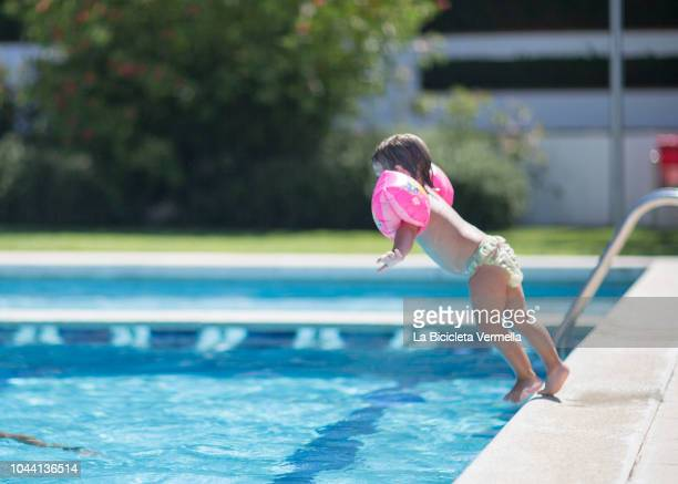 Girl Throwing Herself Into The Pool With Sleeves In Her Arms