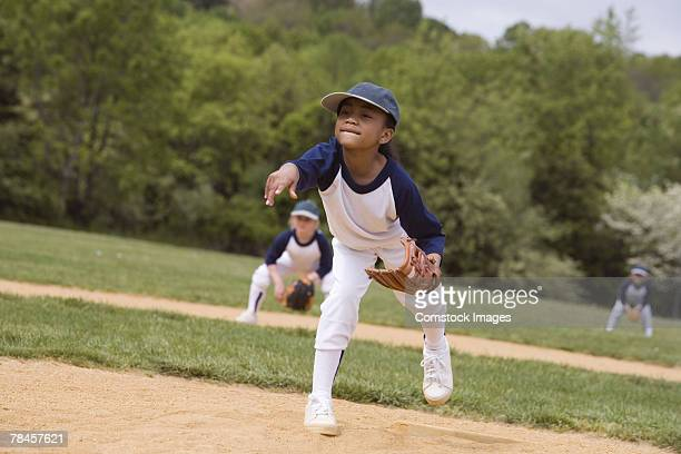 girl throwing in little league softball game - softball stock pictures, royalty-free photos & images