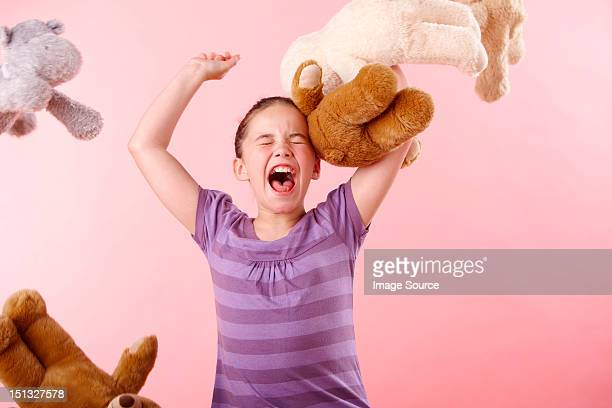 girl throwing teddy bears - tantrum stock photos and pictures