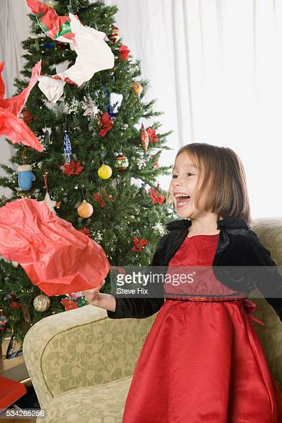 Girl Throwing Wrapping Paper
