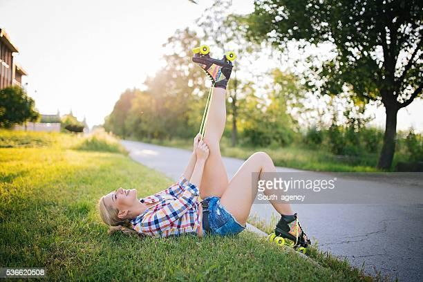 Girl ties shoelaces roller skate