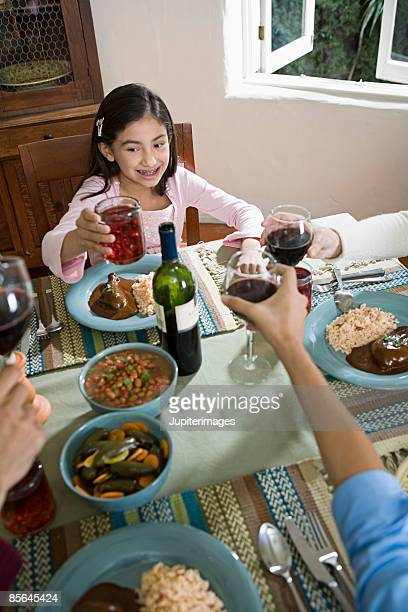 girl toasting at dining table - mole sauce stock pictures, royalty-free photos & images