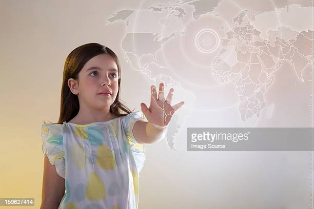 Girl touching virtual world map