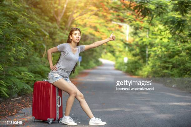 girl tourists waving cars - avenue stock pictures, royalty-free photos & images