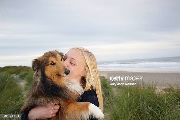 girl ( 14-16) training dog on beach - collie stock pictures, royalty-free photos & images