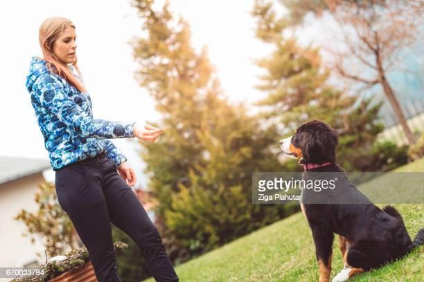 Girl training her dog