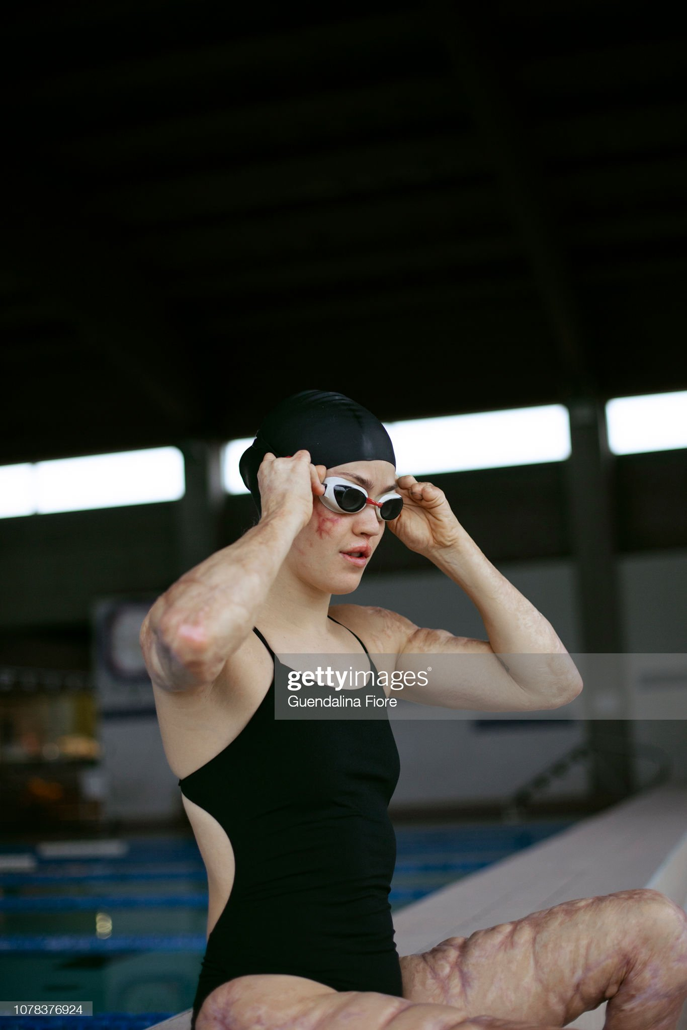 Girl training in the swimming pool : Stock Photo