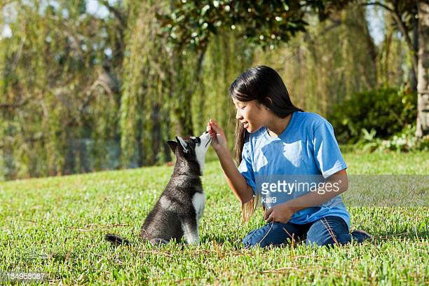 Girl training puppy
