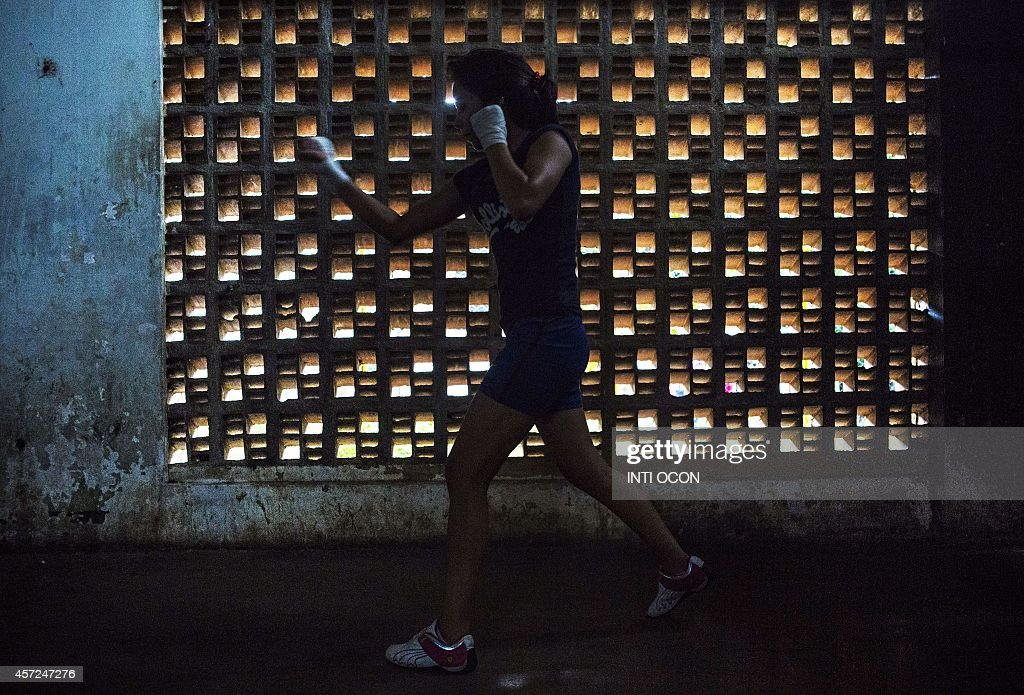 A girl trains at San Judas gym in Managua on October 13, 2014. Nicaraguan low-income youngsters come up to boxing to start a career, in an attempt to succeed and get out of poverty. AFP PHOTO / Inti OCON