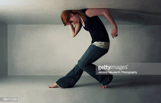 Girl trapped in narrow white space
