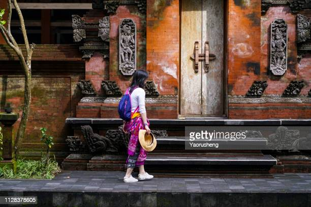 girl travel pura tirta empul temple bali - balinese culture stock pictures, royalty-free photos & images