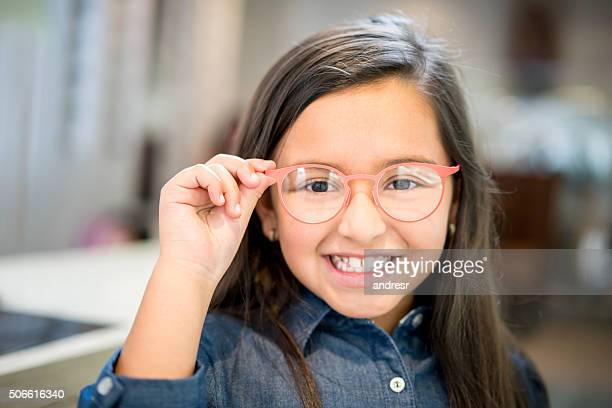 Girl trying glasses at the optician