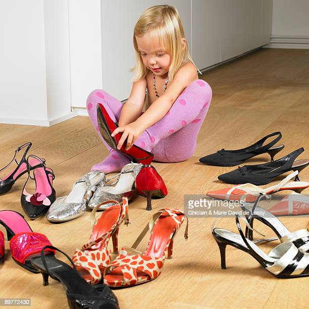 Girl trying on her mother's shoes