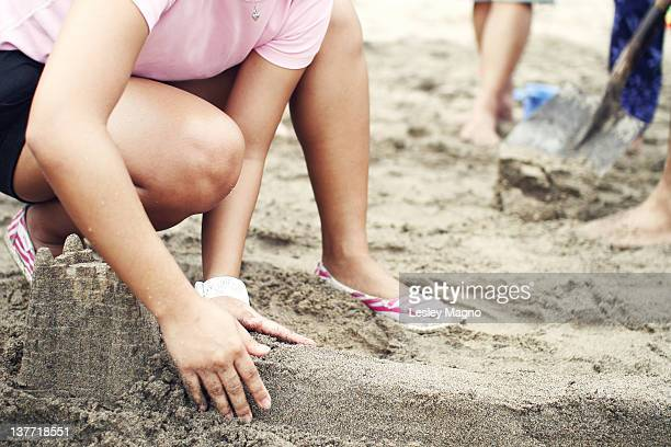 Girl trying to build sand castle