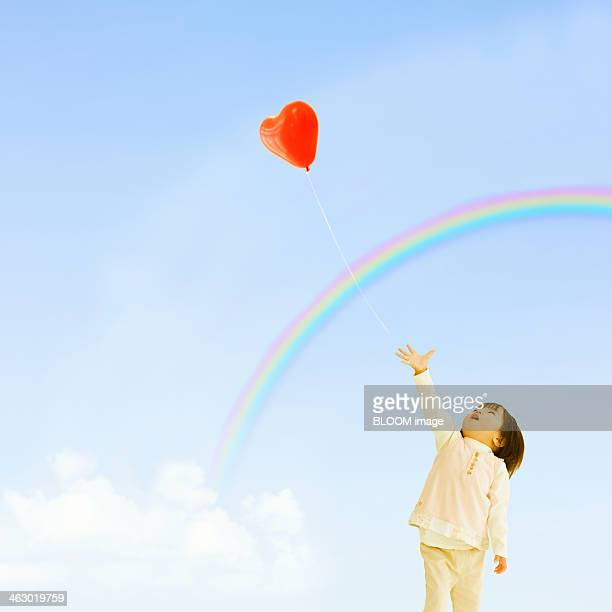 Girl Trying To Catch Balloon