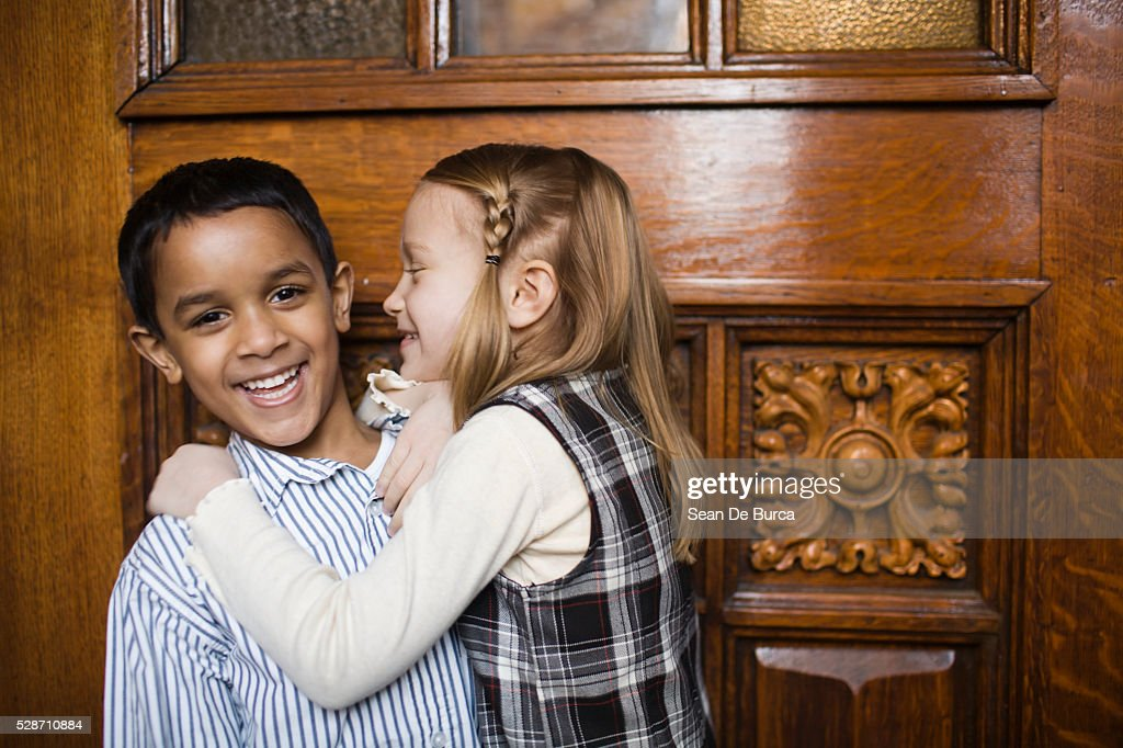 Girl Trying to Kiss Boy : Stock Photo