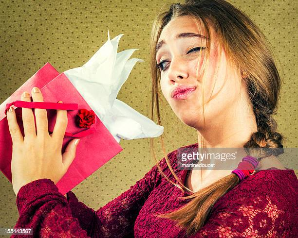 "girl trying to peek in a gift bag. - ""martine doucet"" or martinedoucet stock pictures, royalty-free photos & images"